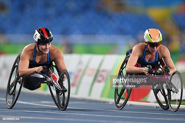 Chelsea McClammer and Amanda McGrory of the United States react after competing in the Women's 1500m T54 heat on day 5 of the Rio 2016 Paralympic...