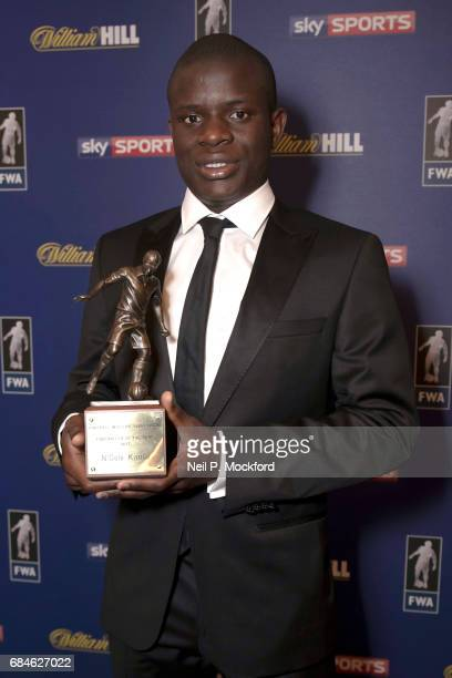 Chelsea Midfielder N'Golo Kante is presented with the FWA Player of the Year Award by Football Writers Association Chairman Patrick Barclay at The...