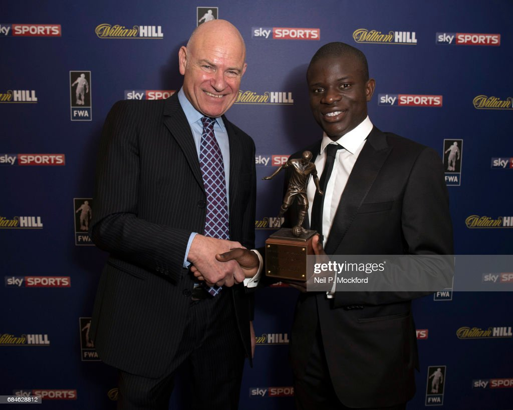 Chelsea Midfielder N'Golo Kante is presented with the FWA Player of the Year Award by Football Writers Association Chairman Patrick Barclay, at The Landmark Hotel on May 18, 2017 in London, England.
