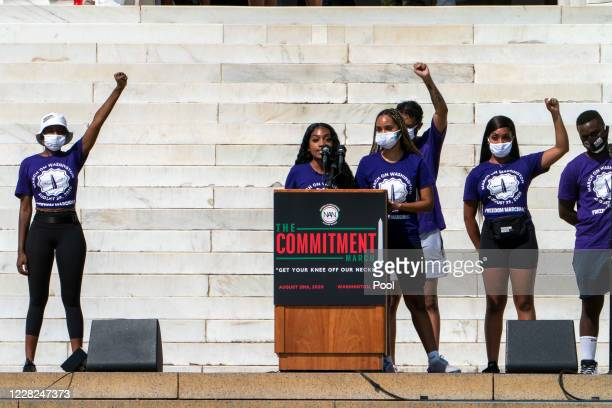 Chelsea Miller, at podium, and Nialah Edari, right of Miller, co-founders of Freedom March NYC, speak during the March on Washington at the Lincoln...