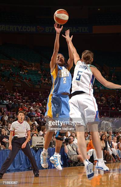 Chelsea Newton of the Chicago Sky shoots against Erin Thorn of the New York Liberty at Madison Square Garden on August 5 2006 in New York City NOTE...