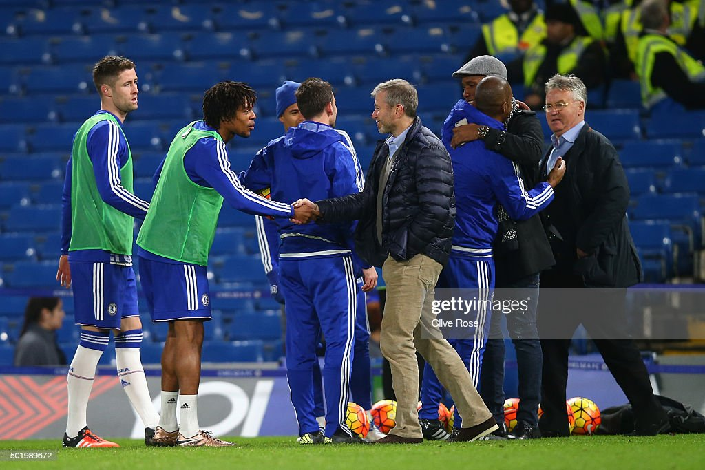 Chelsea owner Roman Abramovich (4th R), Chelsea interim manager Guus Hiddink (1st R) and Didier Drogba (2nd R) of Montreal Impact congratulate players and staffs including Gary Cahill (1st L) and Loic Remy (2nd L) after their 3-1 win in the Barclays Premier League match between Chelsea and Sunderland at Stamford Bridge on December 19, 2015 in London, England.