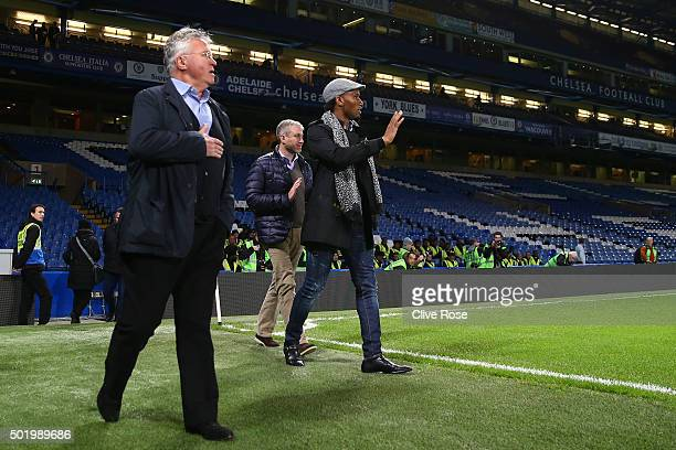 Chelsea owner Roman Abramovich Chelsea interim manager Guus Hiddink and Didier Drogba walk into the pitch to congratulate players and staffs...