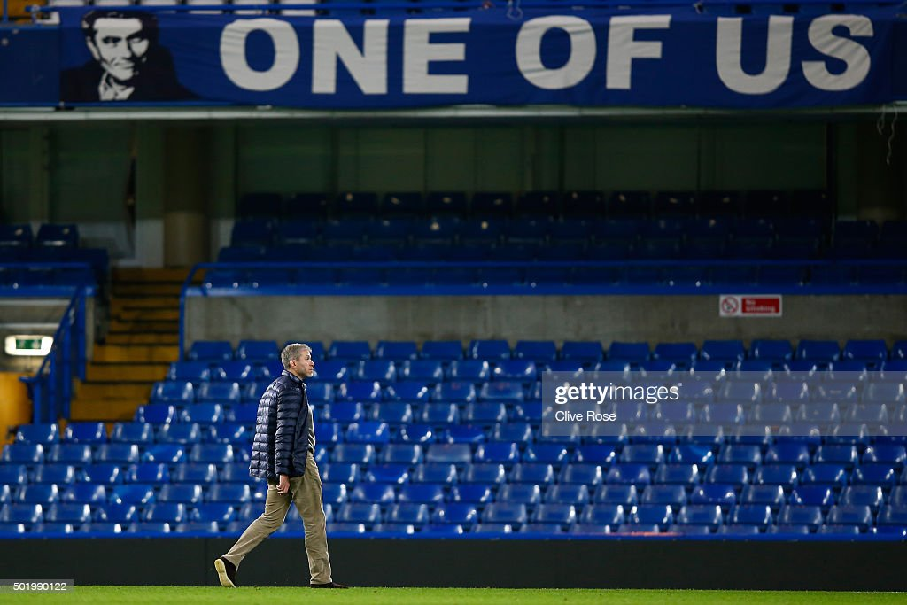 Chelsea owner Roman Abramovich walks past a banner to support Jose Mourinho after their 3-1 win in the Barclays Premier League match between Chelsea and Sunderland at Stamford Bridge on December 19, 2015 in London, England.