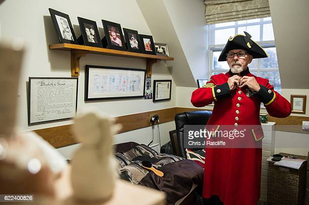 Chelsea Pensioner Alan Rutter buttons up his jacket inside his 'berth' where he lives ahead of attending the Rememberance Sunday service at the...