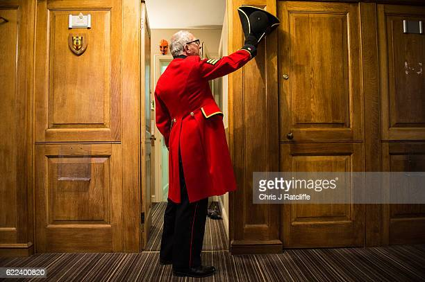 Chelsea Pensioner Alan Rutter tries his hat on in the entrance to his 'berth' where he lives ahead of attending the Rememberance Sunday service at...