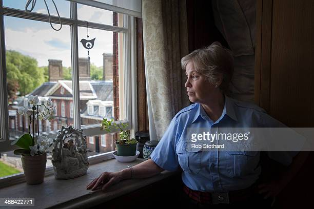 Chelsea Pensioner Barbara Whilds a retired army psychiatric nurse, looks out the window of her room at the Royal Hospital Chelsea, a retirement home...