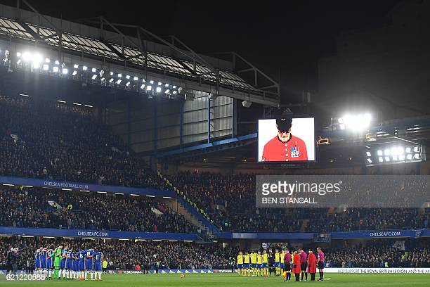 Chelsea Pensioner is shown on the screen as players observe a minute of silence in honour of Remembrance Day ahead of the English Premier League...