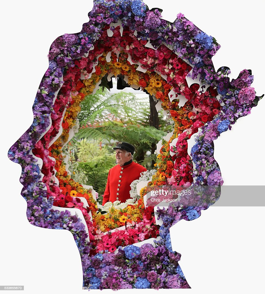 A Chelsea Pensioner looks through the 'Behind Every Great Florist' design at RHS Chelsea Flower Show on May 23, 2016 in London, England.