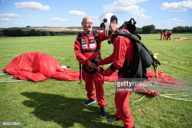 Chelsea Pensioner Mike Smith celebrates after completing his 100th skydive, at the Old Sarum airfield on August 10, 2017 in Salisbury, England....