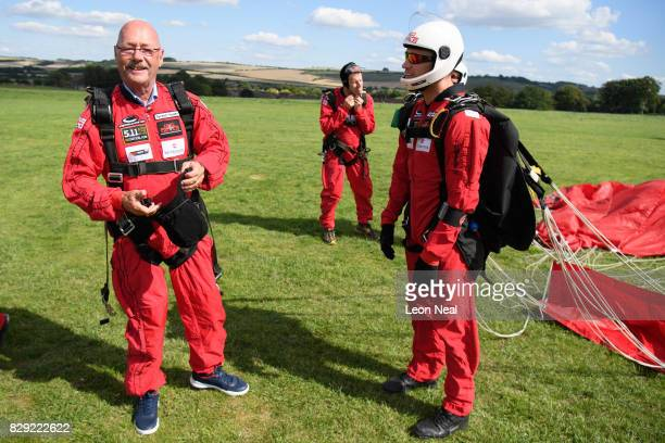 Chelsea Pensioner Mike Smith celebrates after completing his 100th skydive at the Old Sarum airfield on August 10 2017 in Salisbury England Earlier...