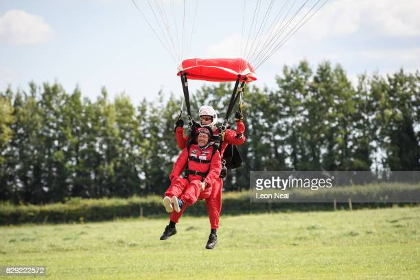 Chelsea Pensioner Mike Smith comes into land after completing his 100th skydive at the Old Sarum airfield on August 10 2017 in Salisbury England...