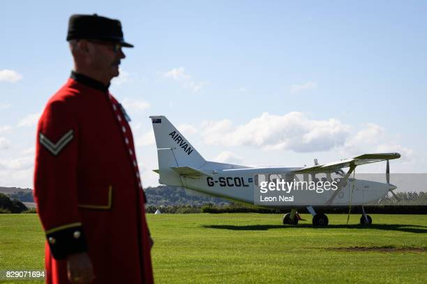 Chelsea pensioner Mike Smith poses for photographs ahead of his 100th skydive at the Old Sarum airfield on August 10 2017 in Salisbury England Former...