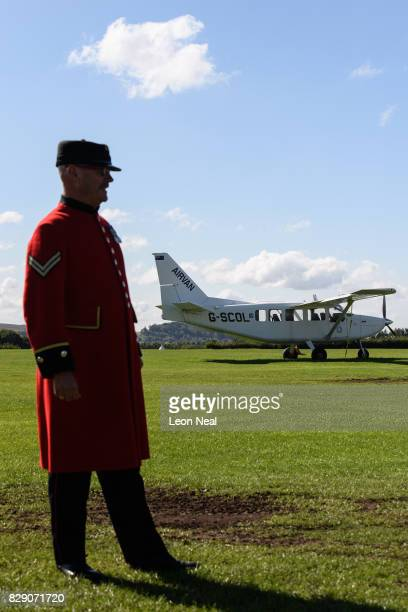 Chelsea pensioner Mike Smith poses for photographs ahead of his 100th skydive, at the Old Sarum airfield on August 10, 2017 in Salisbury, England....