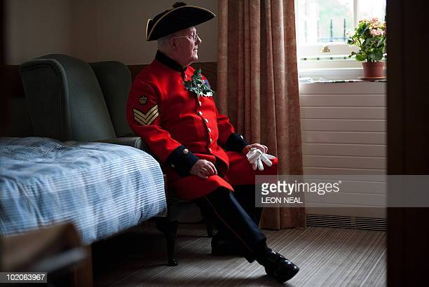 "Chelsea Pensioner Ray Hackett poses for the photographer as he sits in his room, waiting for the start of the annual ""Founder's Day Parade"" at the..."