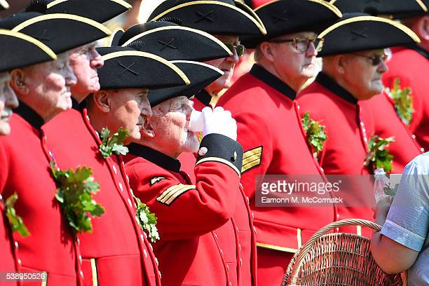Chelsea pensioner takes a drink during the Founders Day Parade at The Royal Hospital Chelsea on June 9, 2016 in London, England.