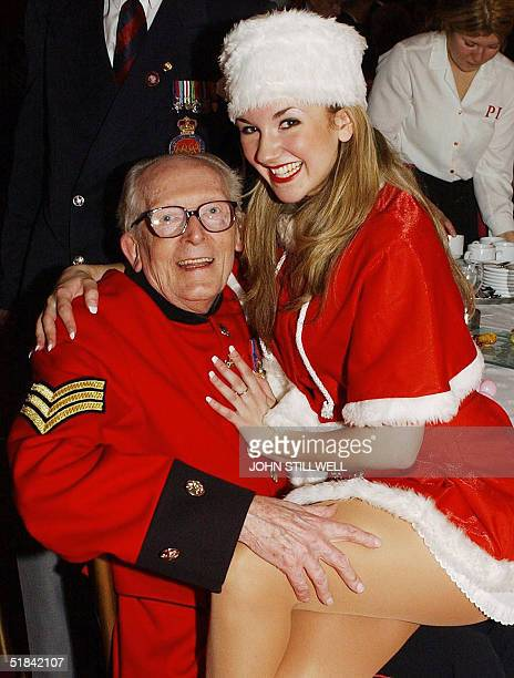 Chelsea pensioner Tony Jaques meets Summer Strallen before meeting the Prince of Wales at the 'Not Forgotten Association' Christmas party at St...