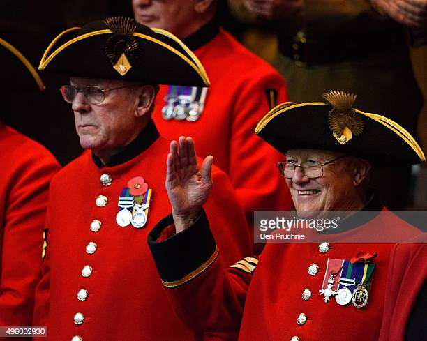 Chelsea Pensioner waves at the audience during the annual GLA remembrance service in City Hall on November 6 2015 in London England The service in...