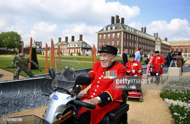 Chelsea Pensioners and war veterans admire the DDay 75 garden designed by John Everiss as a tribute to the heroes of the WWII DDay landings during a...