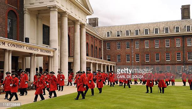 Chelsea Pensioners are pictured after meeting Britain's Prince Harry during the annual Founders Day Parade at the Royal Hospital Chelsea, in London,...