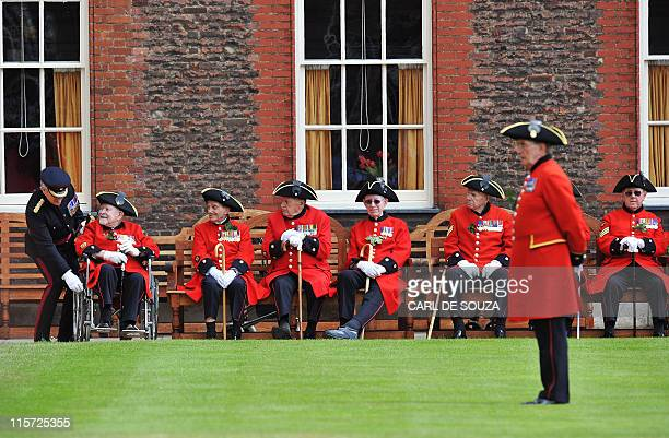 Chelsea Pensioners are pictured before meeting Britain's Prince Harry during the annual Founders Day Parade at the Royal Hospital Chelsea, in London,...