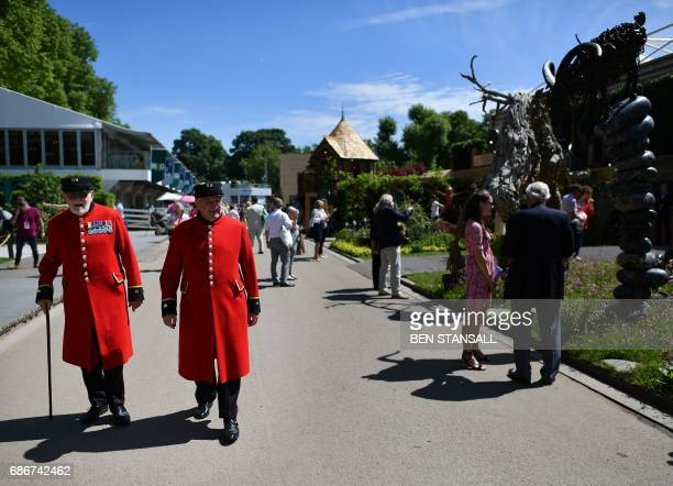Chelsea pensioners are seen walking along the Avenue at the 2017 Chelsea Flower Show in London on May 22 2017 The Chelsea flower show held annually...