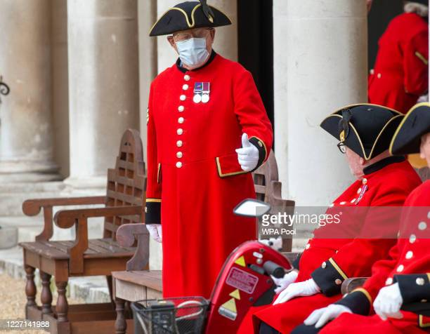 Chelsea Pensioners are seen wearing protective face masks due to the coronavirus outbreak during a visit by Camilla Duchess Of Cornwall to the Royal...