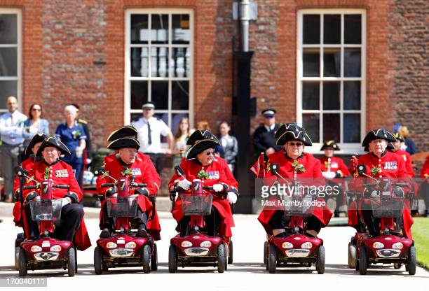 Chelsea Pensioners form up on their mobility scooters as they take part in the Founder's Day Parade at the Royal Hospital Chelsea on June 6, 2013 in...