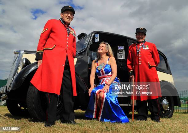 Chelsea Pensioners George Skipper and Ron Carlin pose for a picture with Sally O'Connor in front of a vintage taxi as veterans arrive in London taxis...