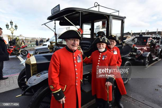 Chelsea Pensioners Henry Puttick, Jim Fellows and John Land pose with a Vintage Poppy Cab as London taxi drivers volunteer their time to transport...