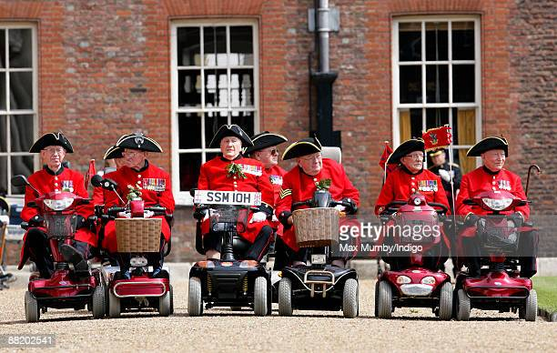 Chelsea Pensioners in mobility scooters attend the annual Founders Day Parade at Royal Hospital Chelsea on June 4, 2009 in London, England.