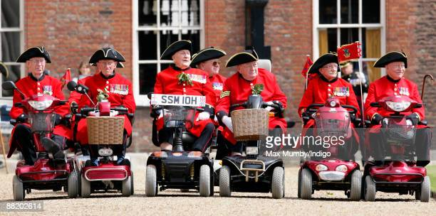 Chelsea Pensioners in their mobility scooters attend the annual Founders Day Parade at Royal Hospital Chelsea on June 4 2009 in London England