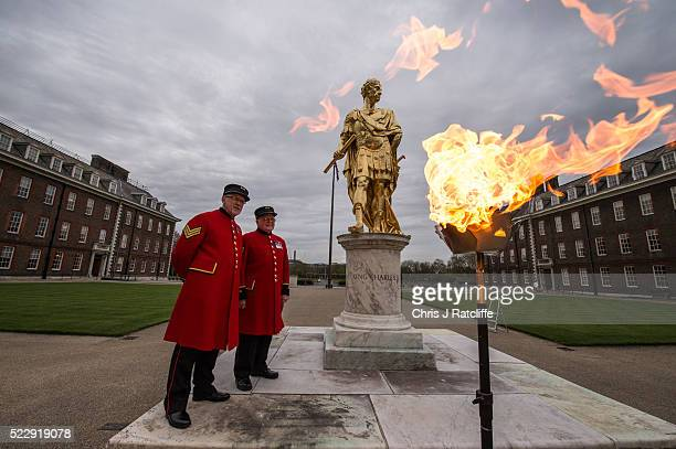 Chelsea Pensioners John Griffiths and Fred Bolwell look at the beacon lit in Figure Court at Royal Hospital Chelsea marking the 90th birthday of...