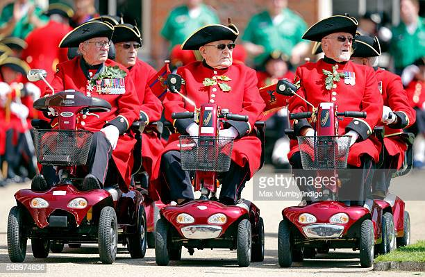 Chelsea Pensioners line up in their mobility scooters as they attend the annual Founder's Day Parade at The Royal Hospital Chelsea on June 9 2016 in...
