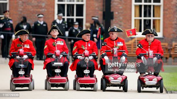 Chelsea Pensioners line up on their mobility scooters as they attend the annual Founders Day Parade at Royal Hospital Chelsea on June 9, 2011 in...