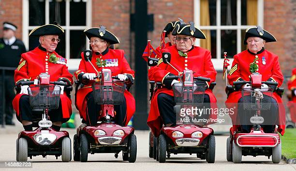 Chelsea Pensioners line up on their mobility scooters as they take part in the annual Founder's Day Parade at the Royal Hospital Chelsea on June 7,...