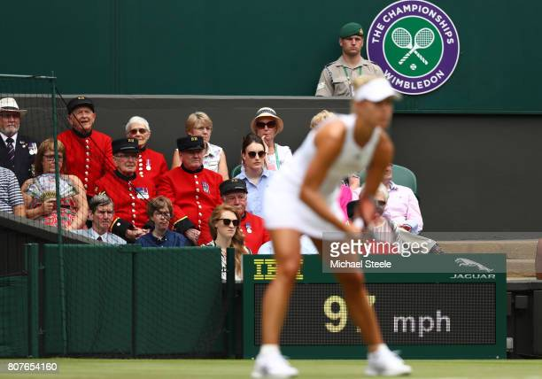 Chelsea pensioners look on during the during the Ladies Singles first round match between Irina Falconi of the United States and Angelique Kerber of...