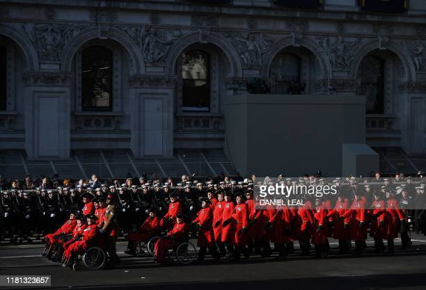 Chelsea Pensioners military veterans take part in a procession during the Remembrance Sunday ceremony at the Cenotaph on Whitehall in central London...