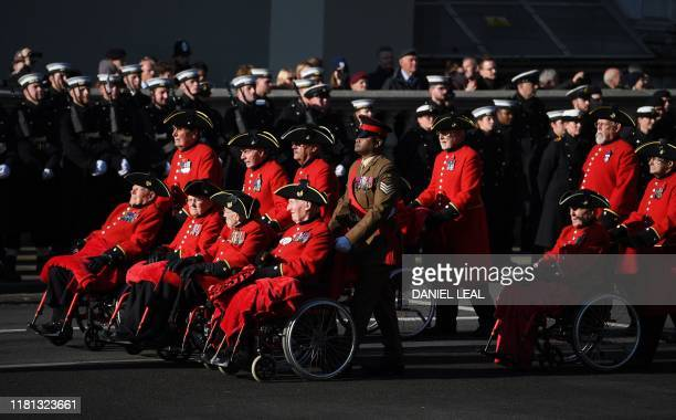 Chelsea Pensioners, military veterans, take part in a procession during the Remembrance Sunday ceremony at the Cenotaph on Whitehall in central...