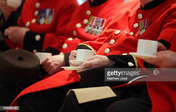 Chelsea Pensioners pause for a tea break during a look round the facilities at Battersea Dogs and Cats Home on February 24 2011 in London England The...