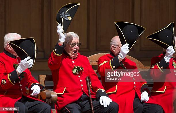 Chelsea Pensioners raise their tricorn hats as they take part in the Founder's Day Parade at the Royal Hospital Chelsea on June 04 2015 in London...
