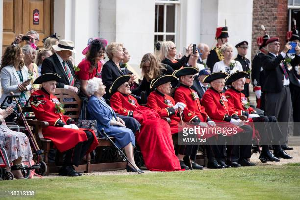 Chelsea Pensioners sit and watch the annual Founder's Day parade at Royal Hospital Chelsea on June 6, 2019 in London, England.