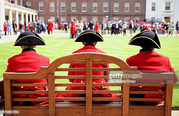 Chelsea Pensioners sit on a bench as they attend the annual Founder's Day Parade at the Royal Hospital Chelsea on June 4 2015 in London England