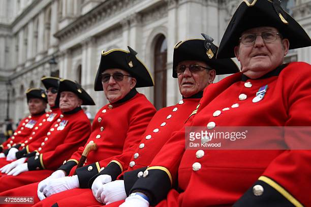 Chelsea pensioners sit on a bench before a tribute at the Cenotaph to begin three days of national commemorations to mark the 70th anniversary of VE...