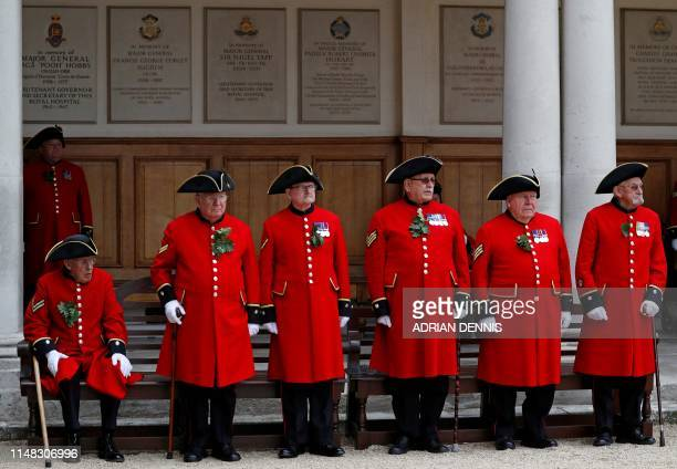 Chelsea Pensioner's stand to attention as they take part in the annual Founder's Day Parade at the Royal Hospital Chelsea in London on June 6, 2019...