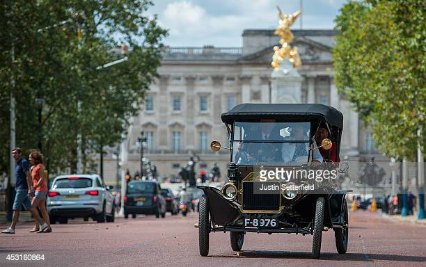 Chelsea Pensioners take part in the Great War centenary parade of Edwardian cars as it passes down The Mall on August 4 2014 in London England Monday...