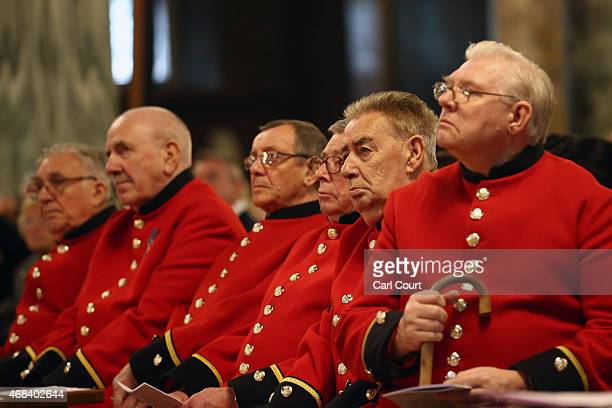 Chelsea Pensioners wait to have their feet cleansed as they attend a Maundy service led by Cardinal Vincent Nichols at Westminster Cathedral on April...