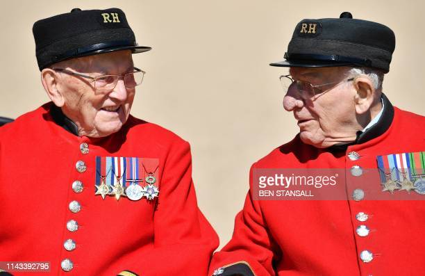 Chelsea Pensioners who is World War Two Battle of Normandy and D-Day veterans Bill Fitzgerald and Fran Mouque pose for a photograph at The Royal...