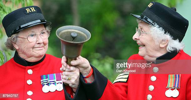 Chelsea pensioners Winifred Phillips and Dorothy Hughes ring the bell to mark the end of the Chelsea Flower Show and the start of the sale on May 23...