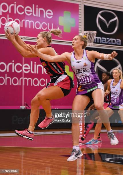 Chelsea Pitman of the Thunderbirds catches the ball in front of Gabi Simpson of the Firebirds during the round seven Super Netball match between the...